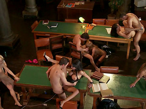 A few horny bitches get their twats slurped and fucked in an orgy