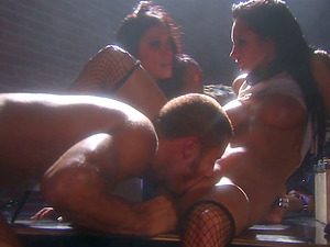 Sexy brunettes in fishnets get pounded in a loft