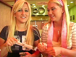 Two pleasurable blondes make some mischievous things in a cafe