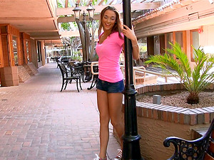 A petite stunner frigs her hairless labia in a clothing shop