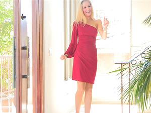 Emily takes off her crimson sundress to showcase her brilliant figure