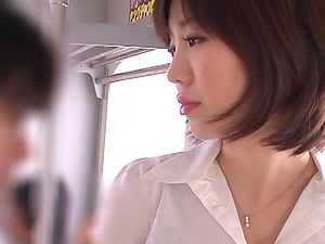 An Asian office lady strokes a dick in a subway train
