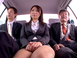 Asian whore has a threesome with two guys in the backseat of a car