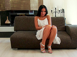 Lovely Black-haired In High High-heeled slippers Posing Lovely On Sofa