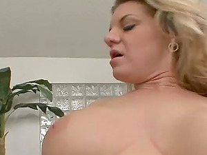 Beautiful Cougar With Faux Tits Providing A Superb Tit fucking