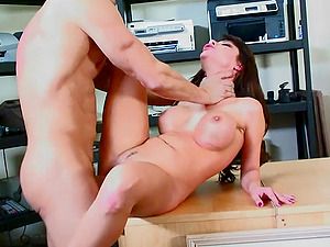 A dude fucks a big-boobed ultra-cutie all over his office and on his desk
