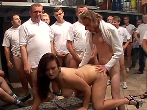 Wild Cougar Gets Group-fucked by a Dozen Guys
