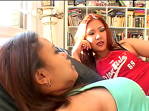 Two Asian lesbos love fingerblasting each other's cunts