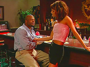 Inari Vachs lets a black stud eat and pound her cunt in a bar