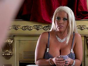 Scorching Blonde In High Stilettos Providing Massive Dick Handjob