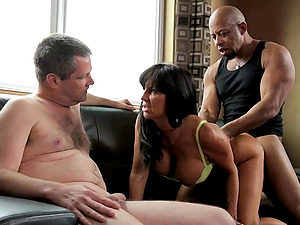 Tara Holiday is pounded by a black monster man sausage as her man observes