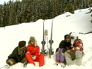 Sexy ladies are fucked out in the snow ina four-way