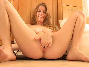 Lovely Bethany playthings her sweet cunt in the bathroom