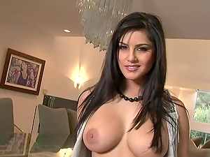 Big titted stunner lets her tits jiggle while she paws her bean