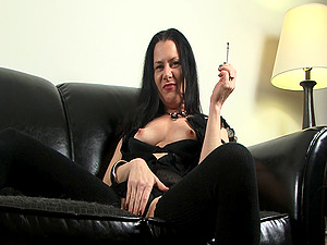 Sexy Cougar with a Smoking Fetish Likes a Smoke on the Couch