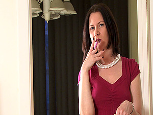 Sexy dark-haired cougar Mina smokes during providing an interview