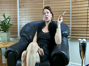 Red-haired cougar Mina smokes and masturbates her bald cunt