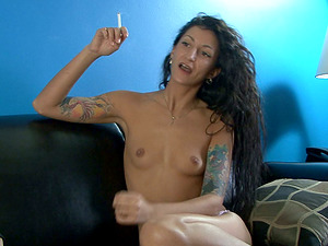 Nude Tattooed Skinny black-haired Smoking Powerfully On A Sofa