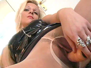 Stunner In Leather And Pantyhose Plaything Fucks Her Cunt Solo