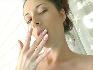 Buxom dark-haired thumbs her raw cunt by an indoor pool
