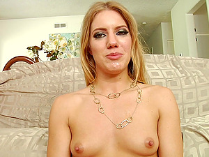 Blonde beauty in a misniskirt shows her tits and butt for the web cam
