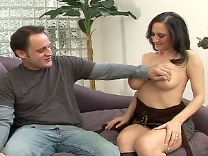 Enticing cougar with big tits providing hot tit job before getting hammered doggystyle