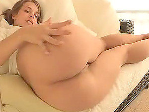 Сlamour lady Sofia is masturbating on the sofa in close-up