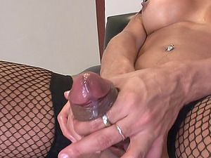 Black-haired shemale Jo Garcia plays with her manstick in hard-core solo vid