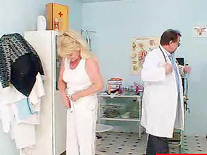 Mature blonde gets her flabby cunt toyed by a gynecologist