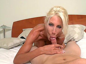 Cougar blonde lady bites her lips when the man she's dating fucks her