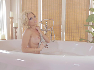Honey Takes Bath After Unwrapping And Displaying Big Faux Tits
