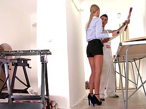 Long-legged blonde in cut-offs leaves her high high-heeled slippers on while providing head