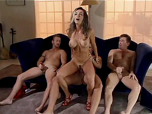 Slender brown-haired chick gets fucked by three studs in a gang-fuck vid