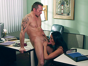 Lengthy haired dark haired in hooter-sling and g-string fucked doggystyle in the office