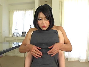 Big-breasted Japanese mom permits a masked dude to knead her tits