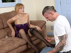 Attractive blonde in a nylon stockings thrilled as she gets a stunning foot munch
