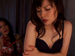 Tied up Asian Tomoko Yanagi gets her butt covered with paraffin wax