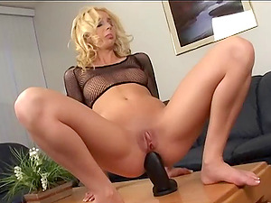 Kelly Wells luvs pounding her snatch with a massive faux-cock