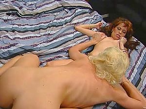 Doting girl-on-girl mummy with big tits getting her cunt gobbled then drilled with a strap on fake penis