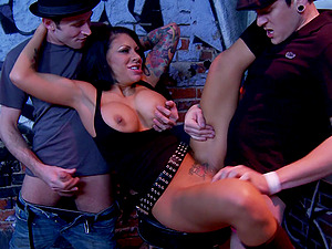 Tattooed Cougar has her mitts total with these two horny guys sausages