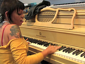 Talented whores covered with tattoos have joy in the music studio