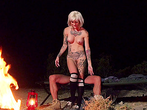 A tattooed honey gets fucked outside by a big bonfire