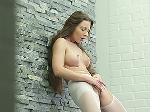 She pulled her pantyhose open and finger fucks her raw slice