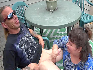 He relaxes on the back porch while an older woman deepthroats his man rod
