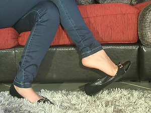 Inexperienced dark haired school female admiring her beautiful feet