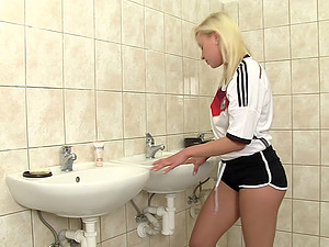 German sports lady sneaks to the restroom to quench her urge for a steamy getting off