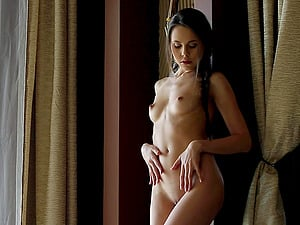 Sweet nubile Abril pleases herself with an erotic onanism