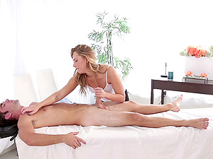 Blonde whore gives a fellow a decent treatment on a rubdown table