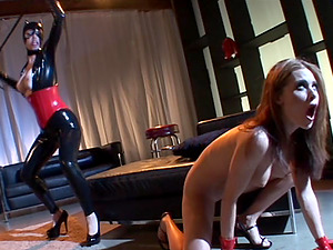 A mistress in a spandex catsuit penalizes her sexy girl/girl gimp