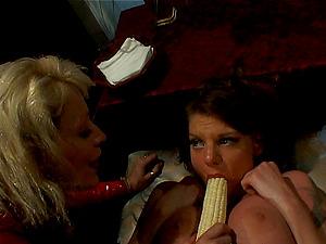 Corn cob, spandex, two mature lesbos, need we say more ?